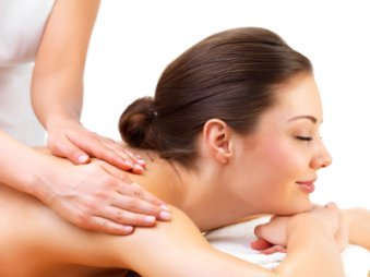 Young woman getting massage from female hands
